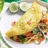 Vietnamese keuken: gegrild varkensvlees en gevulde pannenkoek