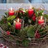 Kerstkrans met waxinelichtjes
